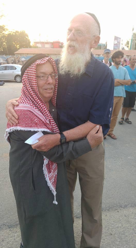 Woche_settlerRabbi+PAMuslim